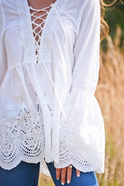 Darling details for days with this unique eyelet top! Belled sleeves, a lace-up neckline, embroidery and a scalloped hemline make it so pretty. Fabric is 100% cotton.