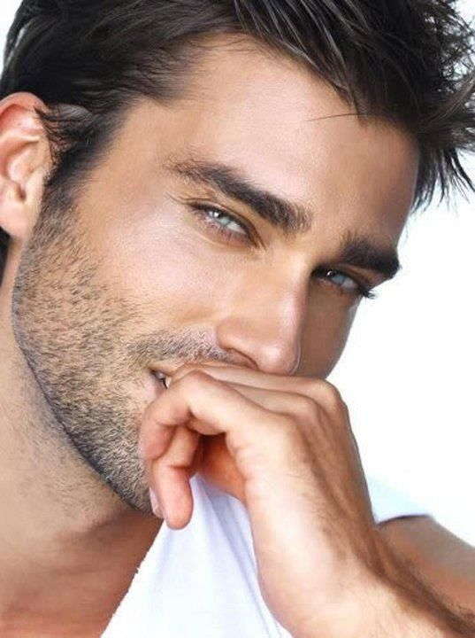 dark hair, light eyes, and the perfect amount of scruff. YUMMM  :)