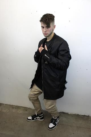 buckled long bomber jacket and distressed khaki joggers