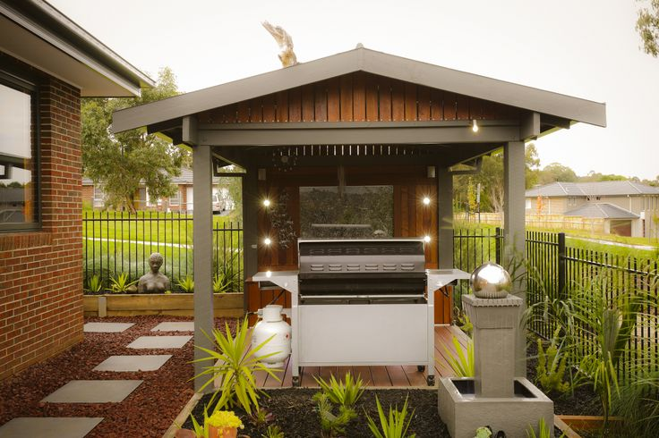 The Range - Custom Designed by Busby Homes. Undercover decked BBQ area. An addition by the owner.