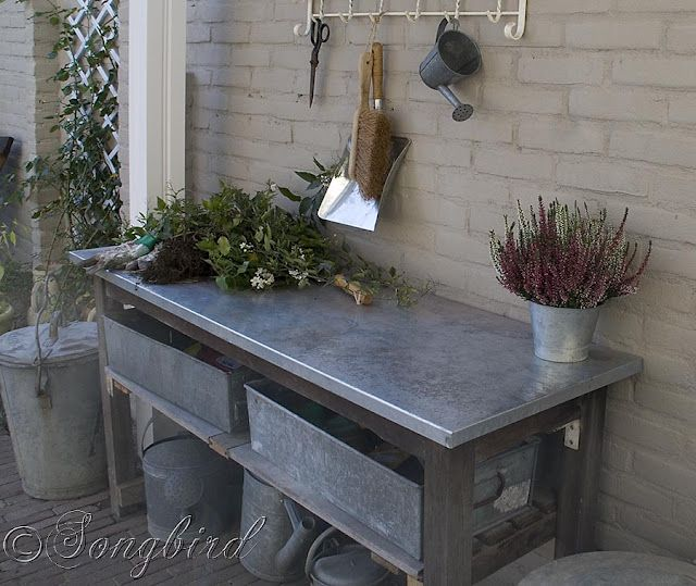 Potting Bench with stainless steel covered top- like this idea a lot for easy cleanup