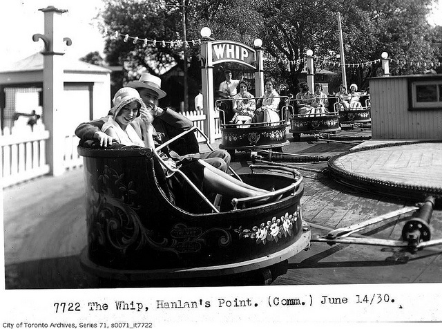 A young couple enjoying a ride on The Whip at Hanlan's Point, Toronto, June 1930. #vintage #Canada #1930s