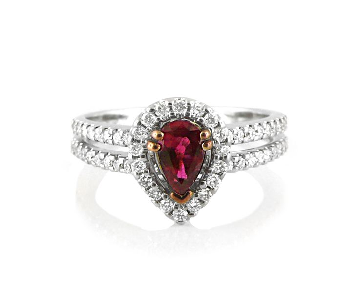 An 18ct White Gold, Ruby and Diamond Halo Ring