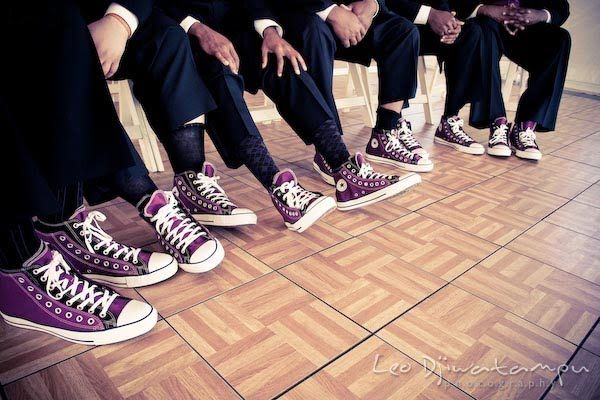 My 2 bridesmen will be wearing purple Chuck Taylors to match their purple vest and tie, and the bridesmaids' purple dresses. The groomsmen (and groom) will wear yellow Chuck Taylors. I am in love with the idea! Puts an edgy but casual twist on a very formal occasion!