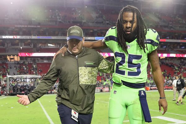 Richard Sherman Photos - Cornerback Richard Sherman #25 of the Seattle Seahawks is helped off the field following the NFL game against the Arizona Cardinals at the University of Phoenix Stadium on November 9, 2017 in Glendale, Arizona.  The Seahawks defeated the Cardinals 22-16. - Seattle Seahawks v Arizona Cardinals