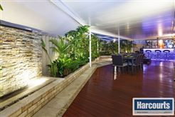 Large outdoor area with decking  To view more of this property check out www.RegalGateway.com #decking #waterfeature #outdorrdecor #backyardideas #homeentertaining #bar #harcourts #realestate