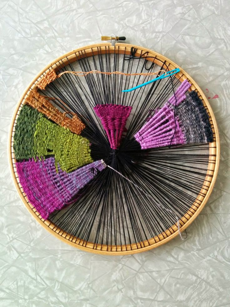 Weaving on an embroidery hoop.
