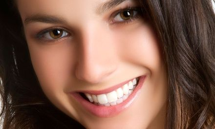 Dental Exam, X-Rays, and Cleaning or Boost Opalescence Teeth Whitening at American Dental Care (Up to 87% Off)