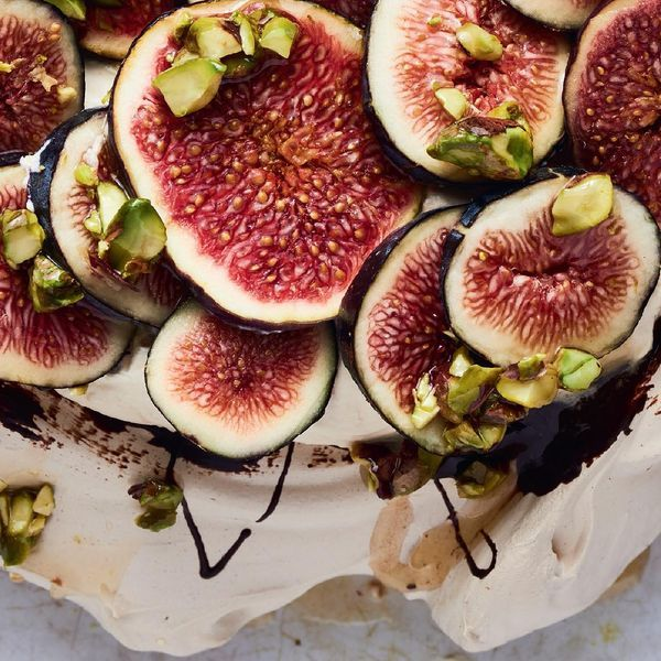 Ottolenghi's recipe for Pavolova, Praline Cream and Fresh Figs is a true showstopper of a dinner party dessert sure to solicit gasps from awed guests.