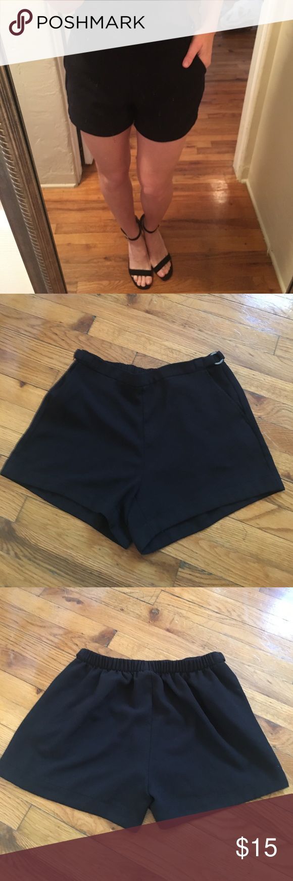 """Calvin Klein Black Shorts Calvin Klein Black Elastic Waist Short. Easy slip on design in polyester blend fabric. Cinched back for flattering pleated look. 3"""" inseam. Metal detail on side with pockets. Can easily be dressed up or down. Worn a handful of times in excellent condition. Calvin Klein Shorts"""