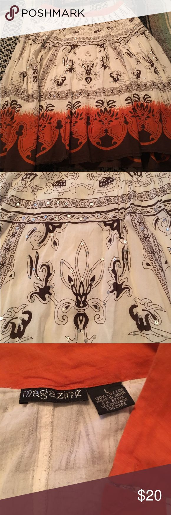Boho festival skirt! Adorable skirt! Tan with brown print and an orange waist. It has sequins and a zippered side. So cute worn to farmers market or any festival. Size is large but I think it would fit a medium better. Hits me right below the knee but would go to the knee or on someone taller. I'm 5'1 for reference. Magazine  Skirts Midi