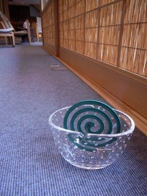 Katori-Senkou(Mosquito coil). Mosquito coil is mosquito-repelling incense, usually shaped into a spiral, and typically made from a dried paste of pyrethrum powder. Pyrethrum was used for centuries as an insecticide in Persia and Europe, and the mosquito coil was developed around 1890s by a Japanese business man. At that time in Japan, people usually mixed pyrethrum powder with sawdust and burned it in a brazier or incense burner to repel mosquitoes.