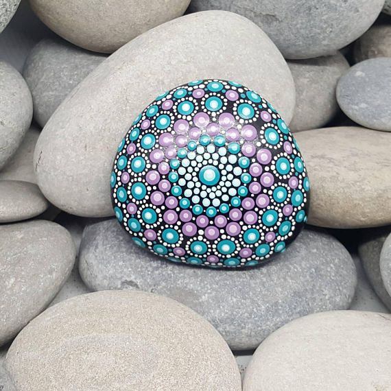 This hand-painted Mandala stone is natural from the beaches of the French Riviera. This painted rock is all black, with detailing in aqua, turquoise and purple with a lighter shade each colour to finish and white detailing. The stone has been coated twice with a clear varnish. Weight: