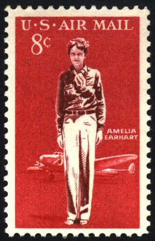 """Issued in 1963, this two color engraved design shows us Amelia Earhart in the foreground, and her Lockheed 10E Special """"Electra"""" aircraft in the background. It was the Lockheed Electra in which Earhart disappeared along with her navigator Fred Noonan in 1937. Aviator heros and their aircraft are popular icons for airmail stamps the world over. This stamp combines both. Fittingly, the carmine and maroon colors match the color of the definetive issue of the day of the same denomination."""