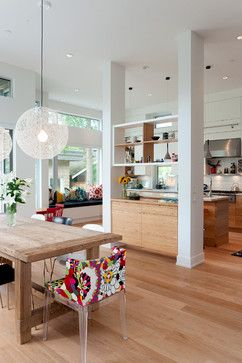 Open plan kitchen/dining space with central suppor…