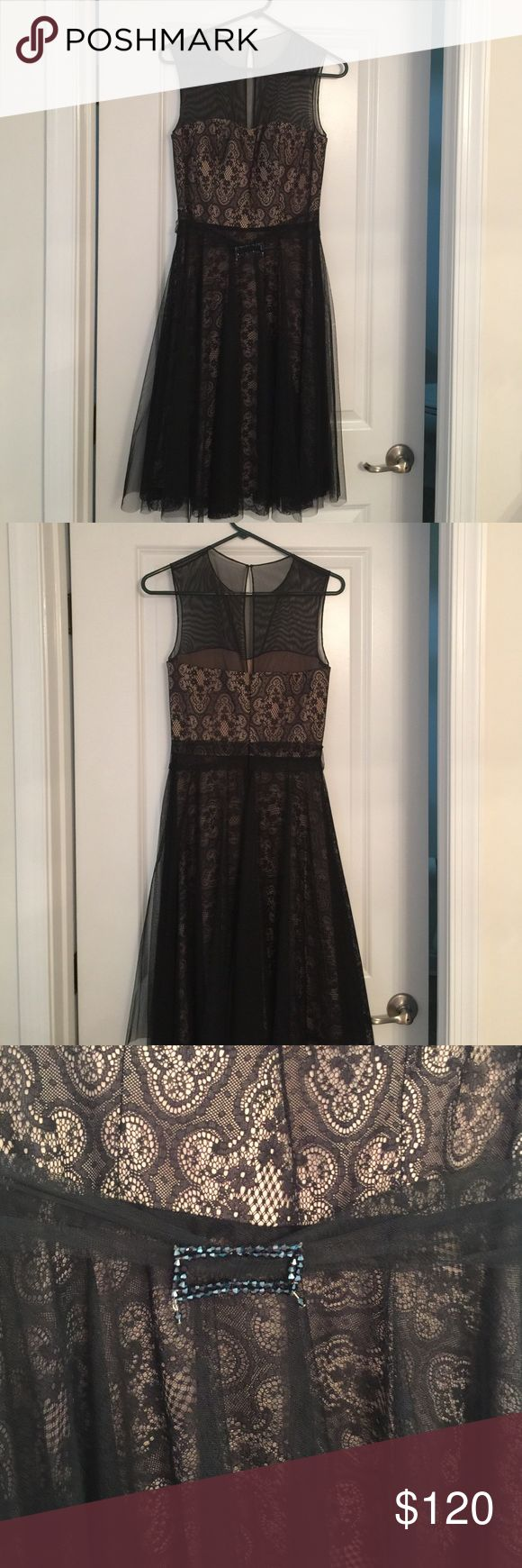 Black and nude cocktail dress. Nude colored cocktail dress with black sheer black tulle overlay. Perfect dress to wear to a wedding or evening event. JS Collections Dresses Midi