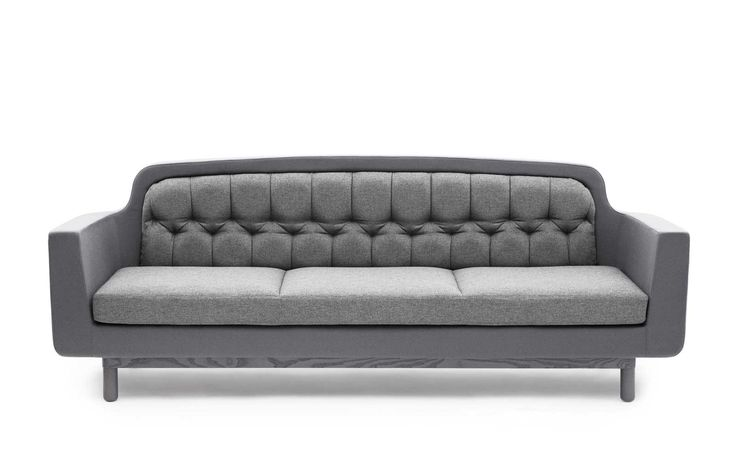Onkel Sofa is a retro inspired sofa designed by Simon Legald. Onkel Sofa has a stitched back and plain-colored frame. Onkel Sofa comes in 5 colors (light grey, dark grey, blue and purple).