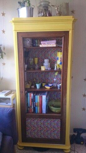 Old closet decorated with shelf liner and yellow paint