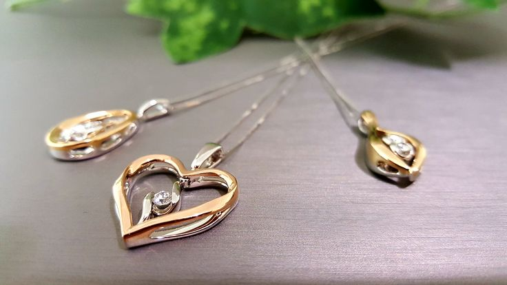 New Sirena Twist Collection, 1 Diamond Pendant, 2 Colours.  These beautiful pendants change with a simple twist of the diamond.  A look for all occasions!  Suspended Diamonds elegantly set with 18k White Gold on one side and 18k Yellow or Rose Gold when the diamond is twisted.