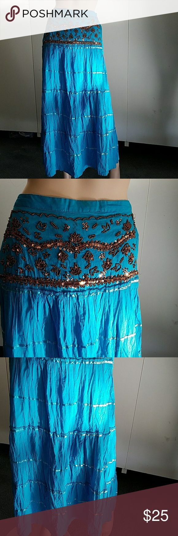 Skirt S/M Blue cotton tiered skirt braids in between tier  . Copper colored sequins and beads in front . Elastic waistband in back Made in India Skirts Midi