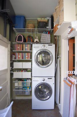 Our new home has stacked washer & dryer... I like the use of space next to & above...