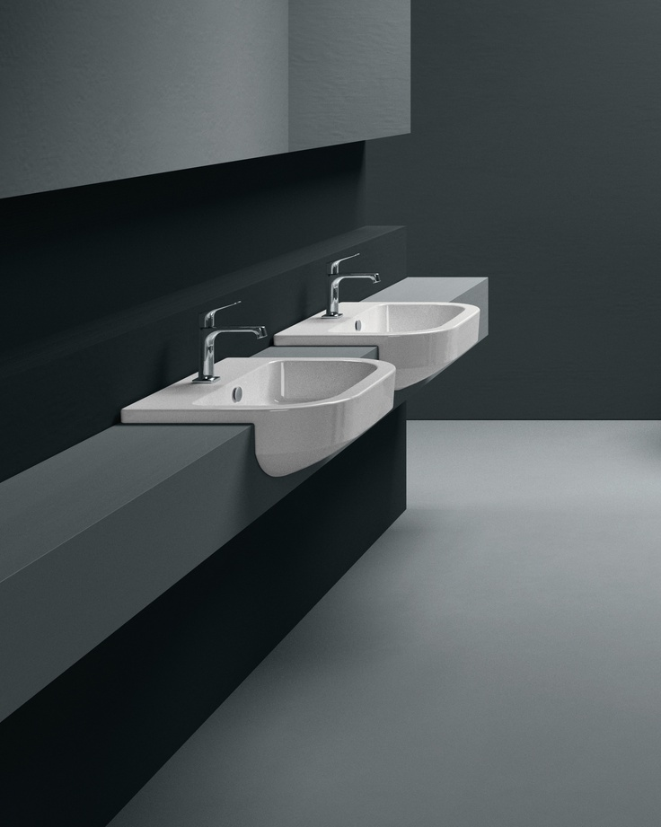 GSI ceramic | Traccia 65/S is a washbasin suitable for semirecessed installation. It is fitted with taps and overflow. A washbasin typical of Traccia collection.  #GSIceramica #BathroomDesign #Washbasins #Sanitaryware
