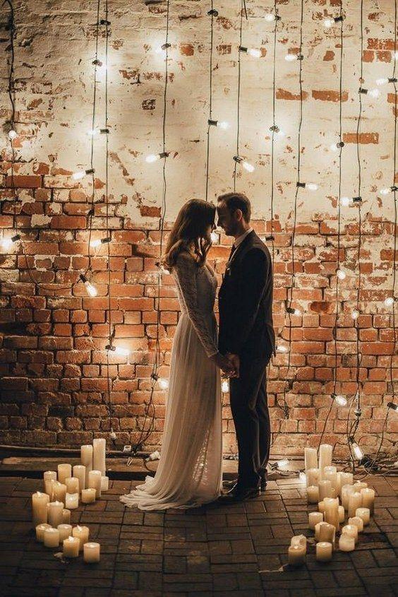 Industrial Candlelit Wedding Backdrop / http://www.deerpearlflowers.com/wedding-ideas-using-candles/4/