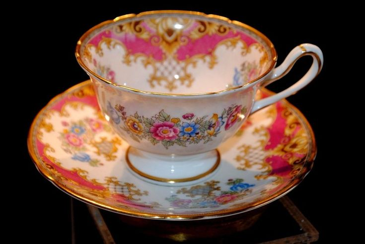 Vintage Shelley Sheraton footed floral tea cup & saucer, England. Pink and gold on white ground, multicolor flowers. English china teacup.