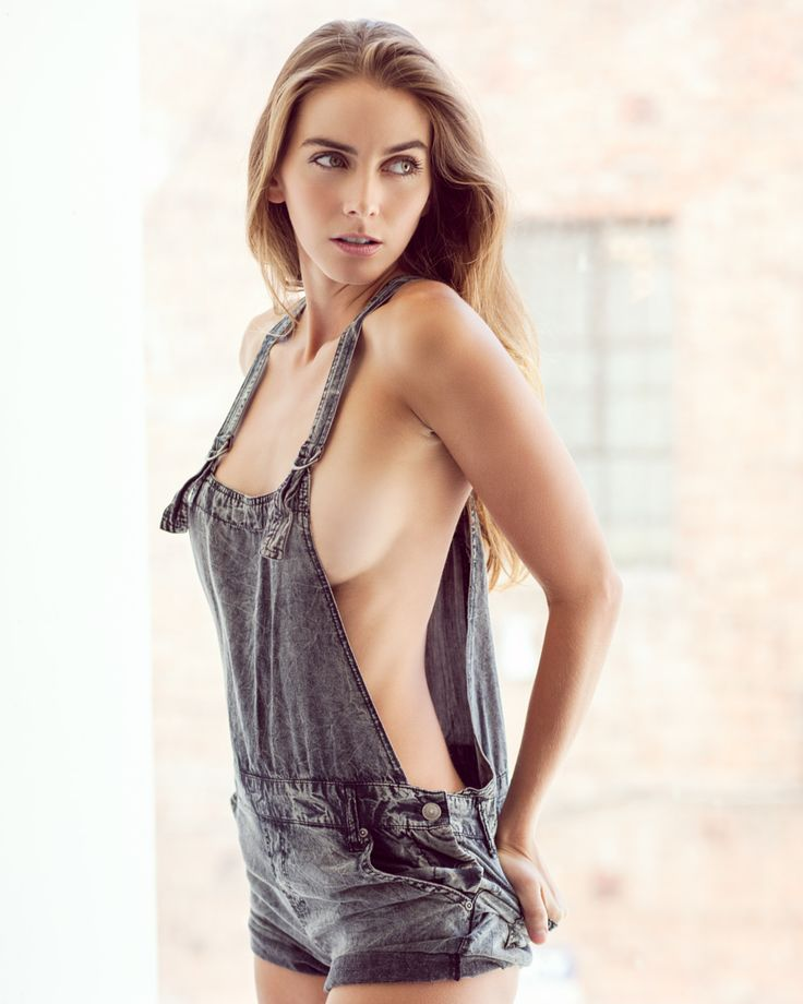 nude female in dungarees