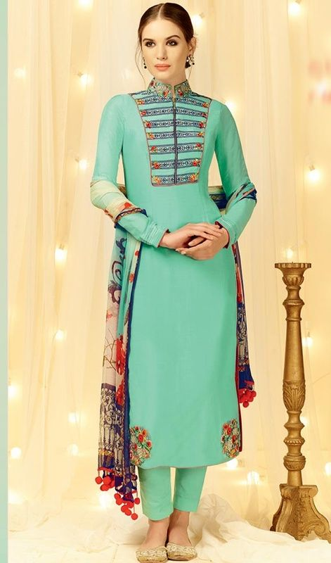 Look absolutely elegant donning this turquoise color embroidered cotton and satin pant style suit. The ethnic lace, patch and resham work for the apparel adds a sign of magnificence statement with your look. #designercasualsuits #printedduppatadress #straightcutsalwarkameez