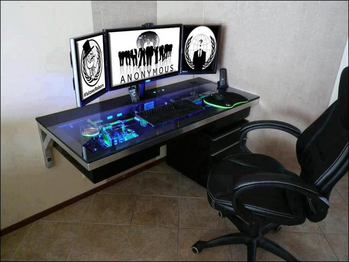 custom made desk with the pc internals built into it now this is a basement office setup 3 primary