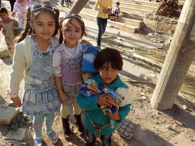 Children in Halab, Syria, smiled and laughed during Eid ul-Adha 2014.
