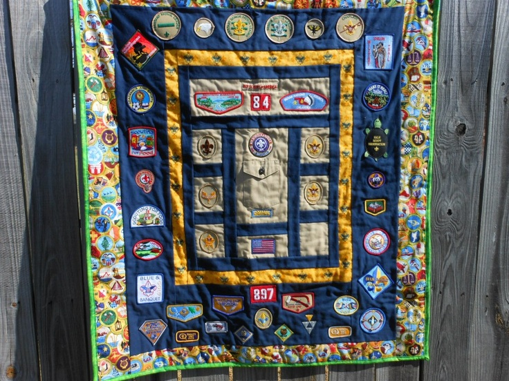 Scouting Memories, made with all the patches the Scout earned and his first official Boy Scout shirt. Eagle patch will go on the pocket and the Life patch will fill the last square.