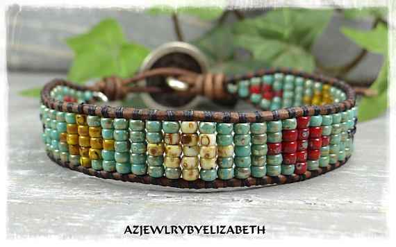 MENS LEATHER WRAP BRACELET NATIVE AMERICAN STYLE/ MENS LEATHER WRAP BRACELET/ SOUTHWESTERN LEATHER BRACELET/ SEED BEAD BRACELET/ BEADED WRAP BRACELET/ BEADED BRACELET. YOU HAVE YOUR CHOICE OF MANY BUTTONS. IF THERES AN ITEM WITH A PARTICULAR BUTTON YOUD LIKE ON ANOTHER BRACELET,