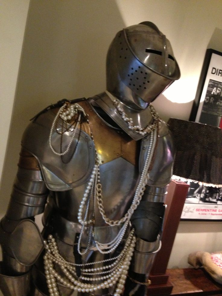 Ye olde looking suit of armour... With a pearl necklace...
