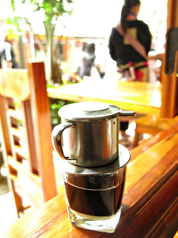 A Coffee Lovers Guide to Vietnamese Coffee - in Bac Ha trying hot drip coffee with Condensed Milk