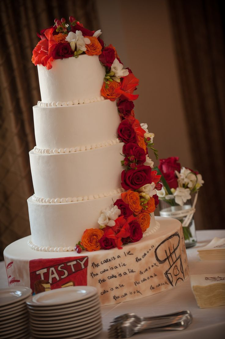 wedding cakes in lagunbeach ca%0A Orange and Red florals cascading down a gorgeous brides cake with a nod to  the couple u    s