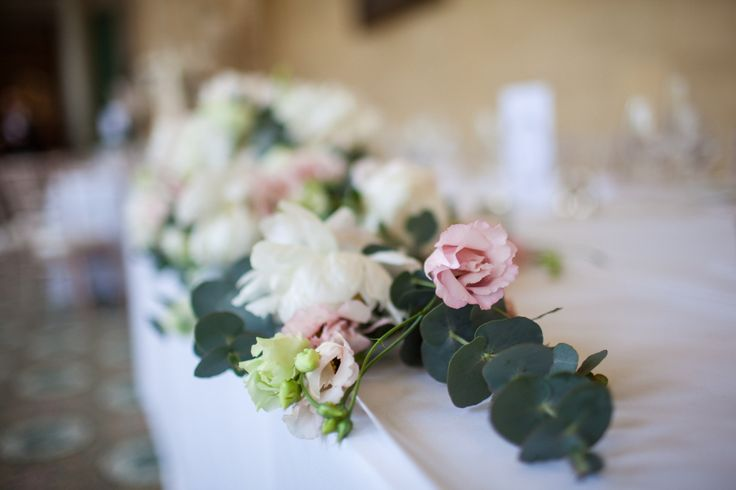 Traditional top table display at Woburn sculpture gallery wedding.  Created by wild orchid.  Blush and white wedding flowers