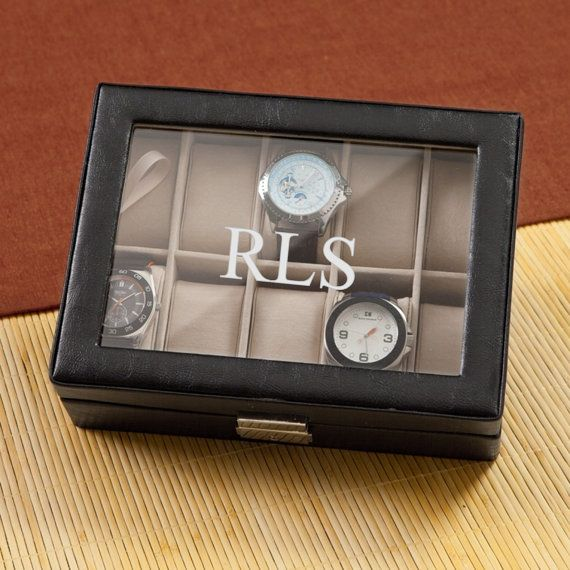 Personalized Leather Watch Box makes a great groomsmens gift or fathers day gift! Made with a black leather exterior and clear glass top with a hinged opening on one side and a clasp that locks on the other. This watch box is multi-functional, arriving with 10 display cushions that can also be removed to use the compartment for rings, coins, cufflinks or any other accessory item. Expertly personalized by engraving directly onto the glass for a lasting keepsake he will treasure…