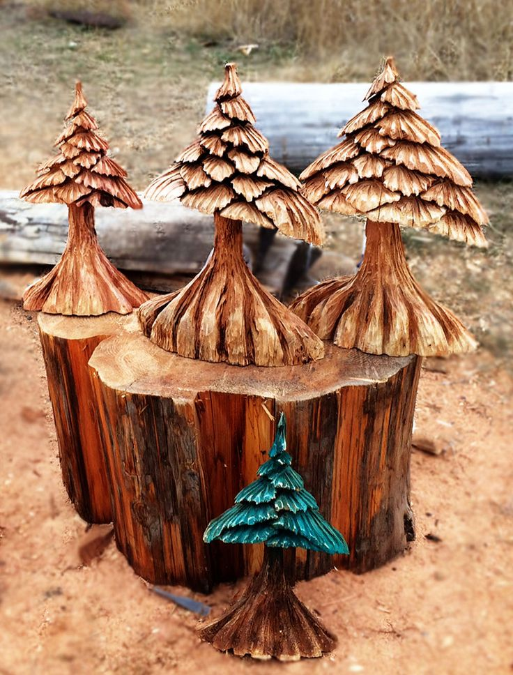 Handcrafted chainsaw tree carvings from pioneer log homes