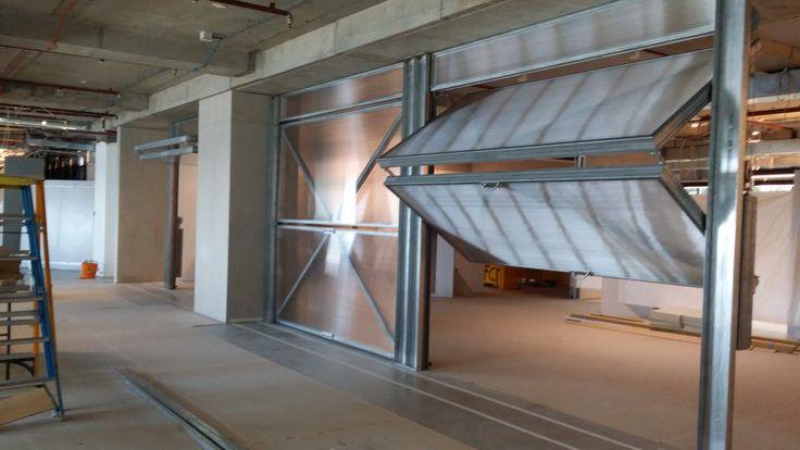 Foldaway Counterweight Bi Fold Doors manual, galvanised frame - industrial look.
