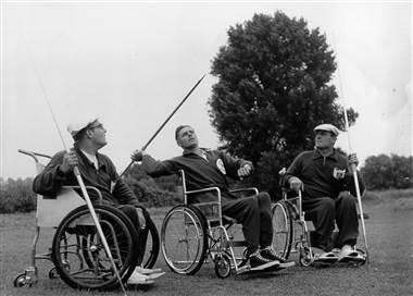 Three paralyzed British fighter pilots compete in the javelin toss at the Stoke Mandeville Games, predecessor of the Paralympics, near London, circa the early 1950s.