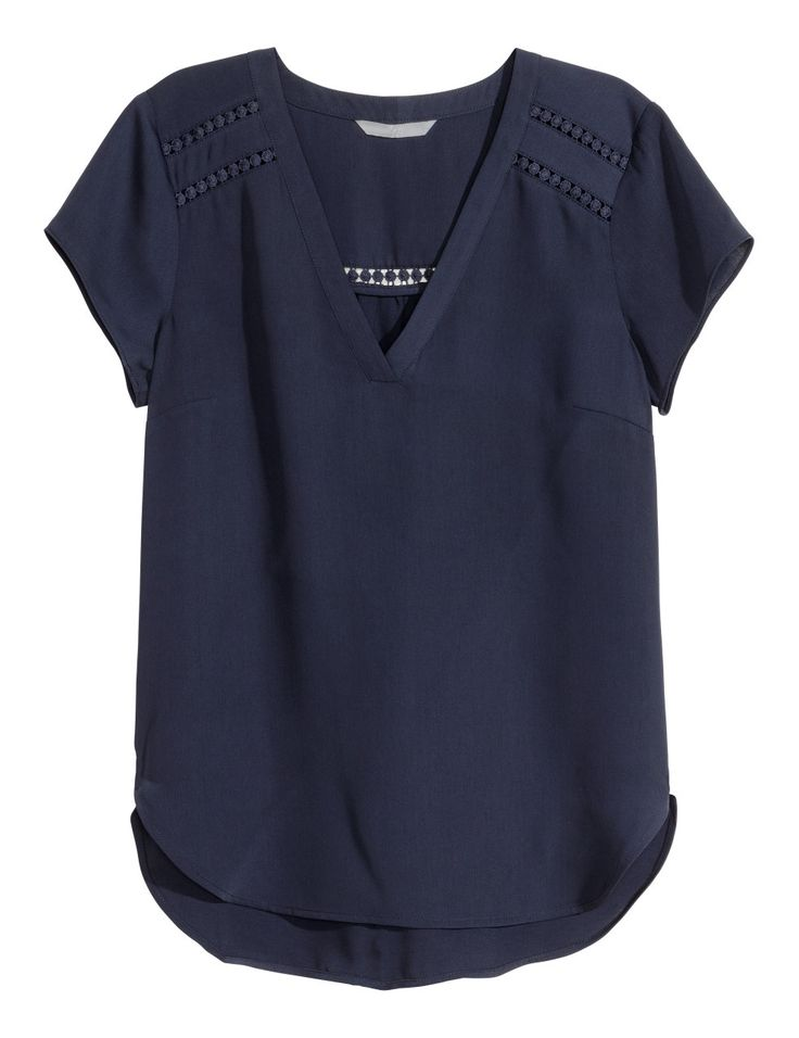 Check this out! Short-sleeved, V-neck blouse in airy woven fabric with lace trim inserts and a gently rounded hem. Slightly longer at back. - Visit hm.com to see more.