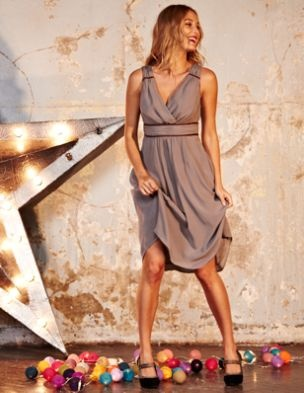 It's floaty and feminine and the flattering crossover front and ruching at the empire line make this a winner for a Winter wedding. But this is a dress with several strings to its bow. It's perfect for a party, but equally useful for a smart dinner.