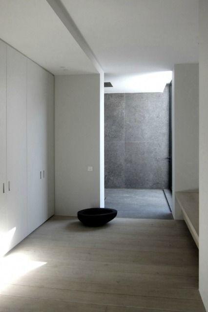 Walk in shower clad in Belgian blue stone. V-T Residence by Vincent Van Duysen