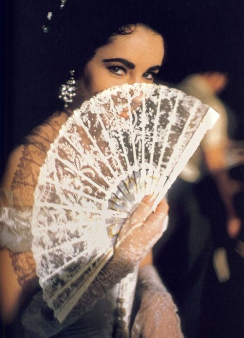 Elizabeth Taylor with hand fan.
