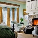 Fireplace In A Green Based Farmhouse Bedroom Design With Windows Curtains And Live Plants Decorations