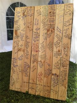 What an idea! Instead of signing a guest book that gets put away, they signed the top of a table so they can enjoy the well wishes everyday! Idea by In The Moment Party Planners