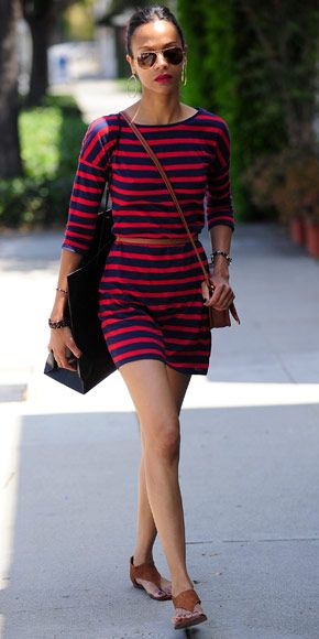 Zoe Saldana in striped Express dress, leather crossbody, and camel-colored sandals