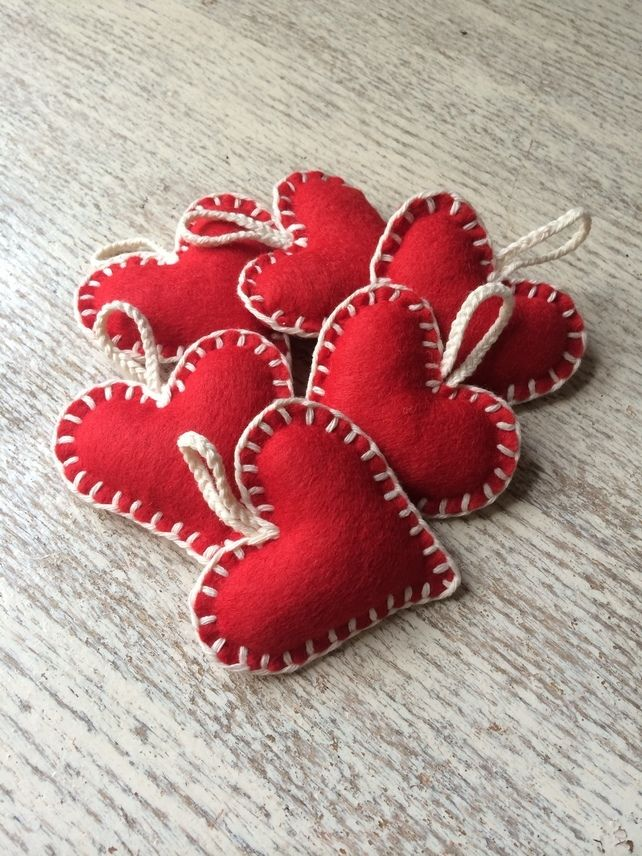 Handmade red felt heart with contrasting white blanket stitch, hung on plaited cotton. Perfect for creating a traditional, vintage or Scandi Christmas style.
